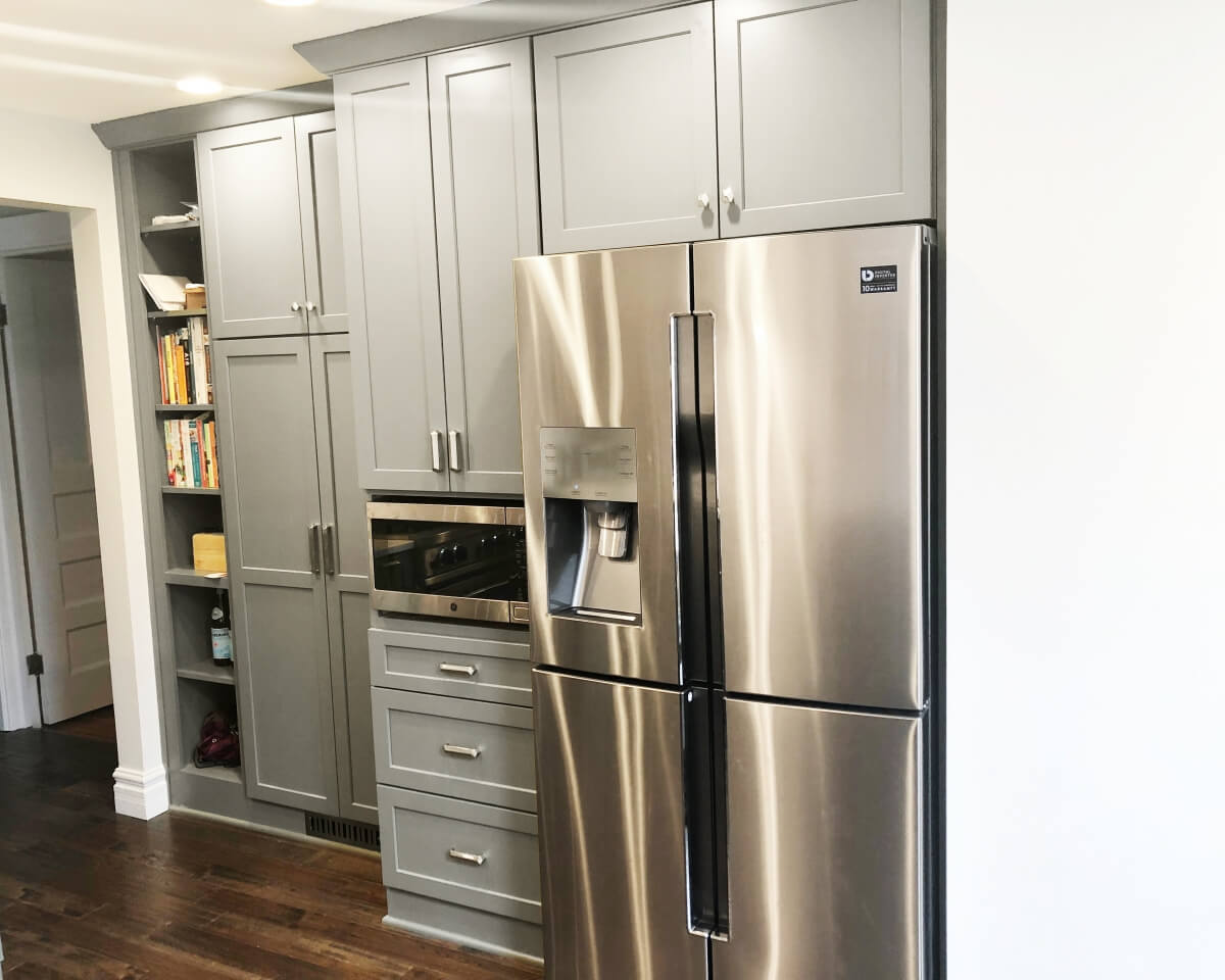 The original appliance locations were separated to reduce the feeling of crampedness in the kitchen.