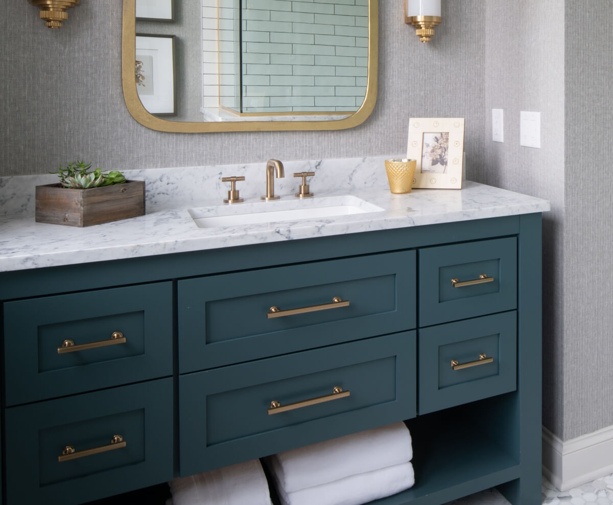 This stately bathroom with brass accents was designed by Studio M Kitchen & Bath and Interior Design by Studio M Interiors, Minnesota.