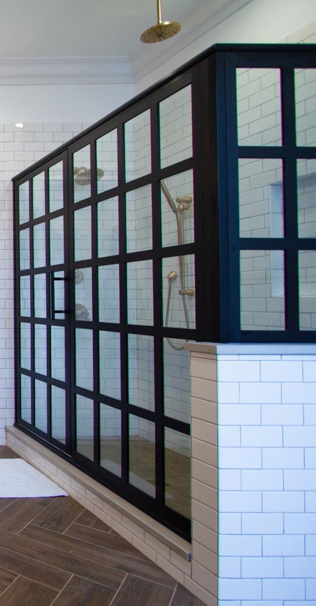 Industrial styled shower in a Dura Supreme bathroom designed by Devin Mearig of dRemodeling